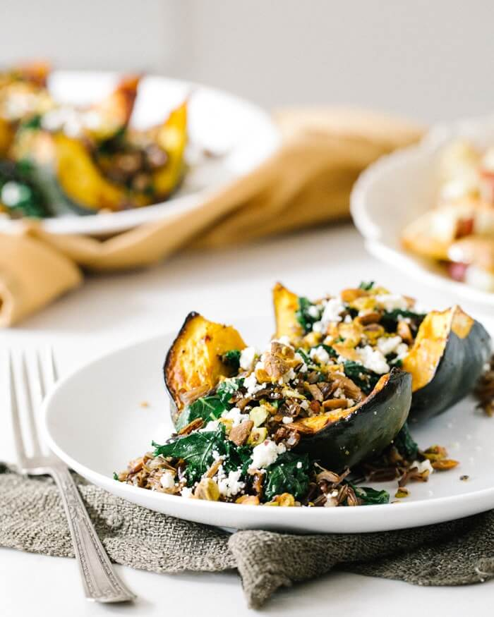 Roasted Acorn Squash with Wild Rice Pistachio Stuffing | A Couple Cooks