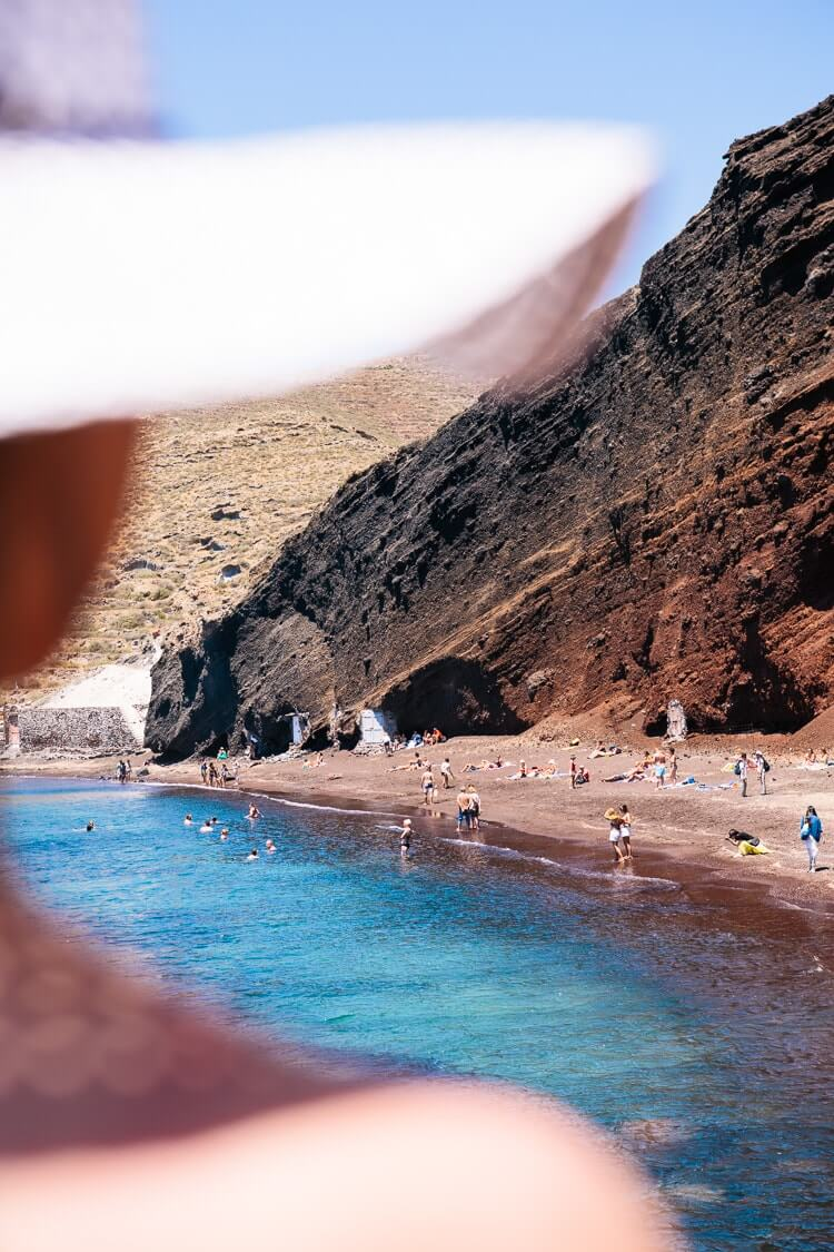 Santorini beaches | The Red Beach | Woman in hat