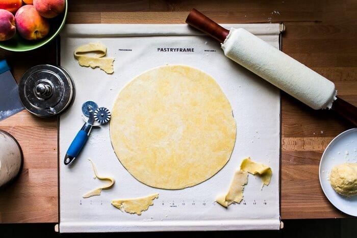 Cutting homemade pie crust dough into a circle