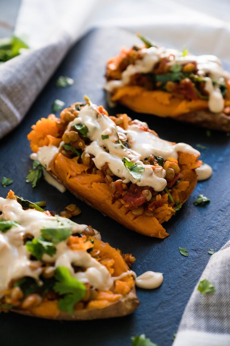 Healthy baked sweet potato with Moroccan lentils