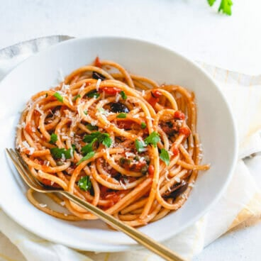 vegetarian pasta in white bowl with fork