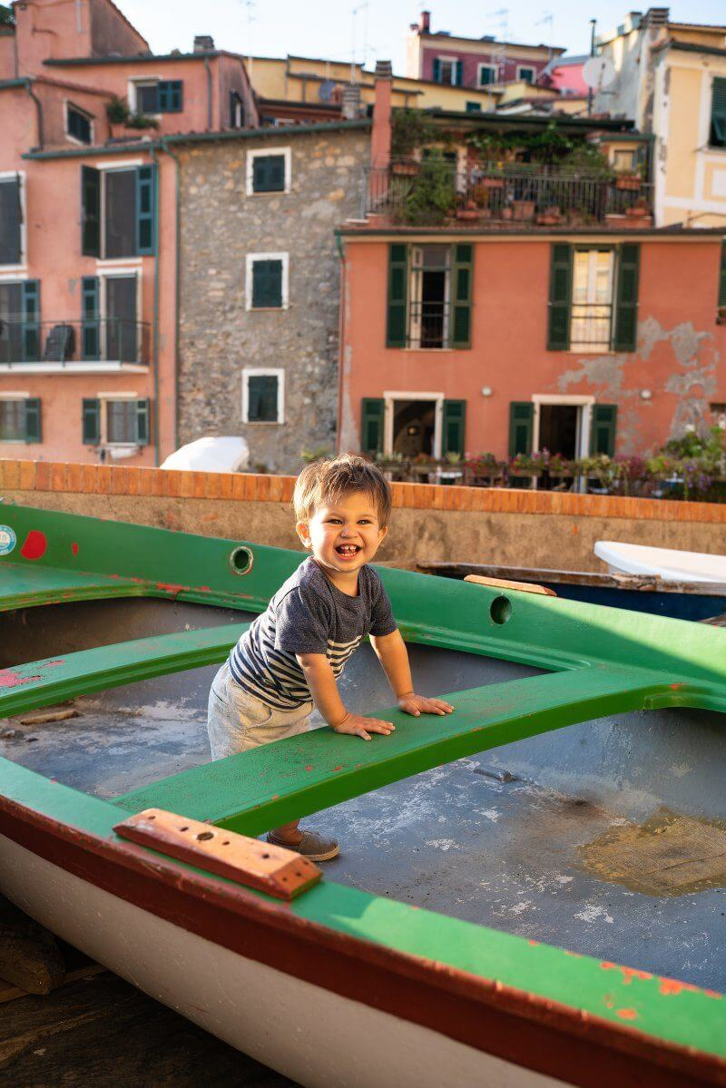 Traveling with a Toddler | Europe with toddlers | Boy in boat in Italy