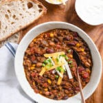 Easy Vegetarian Chili - you won't miss the meat with this crowd pleasing recipe!