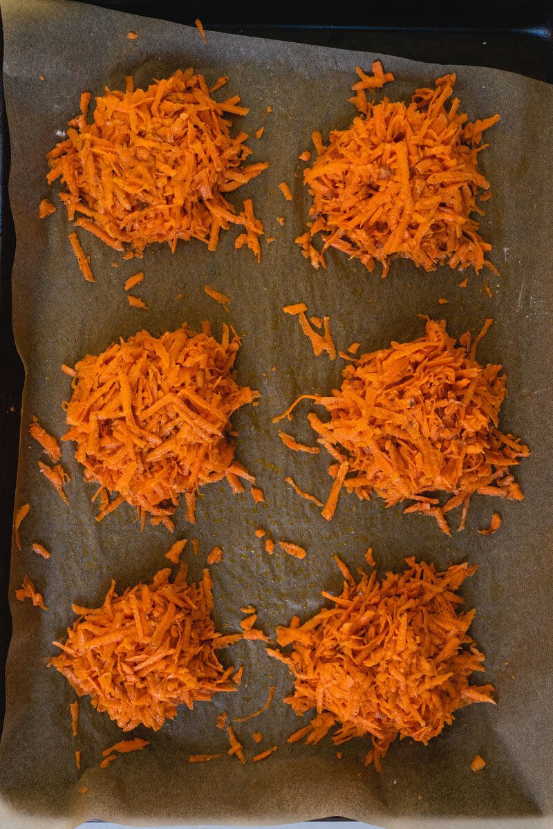 raw sweet potato hash browns on baking sheet