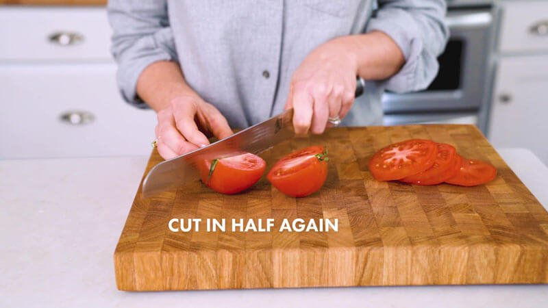 How to Cut a Tomato | Cut the tomato into quarters