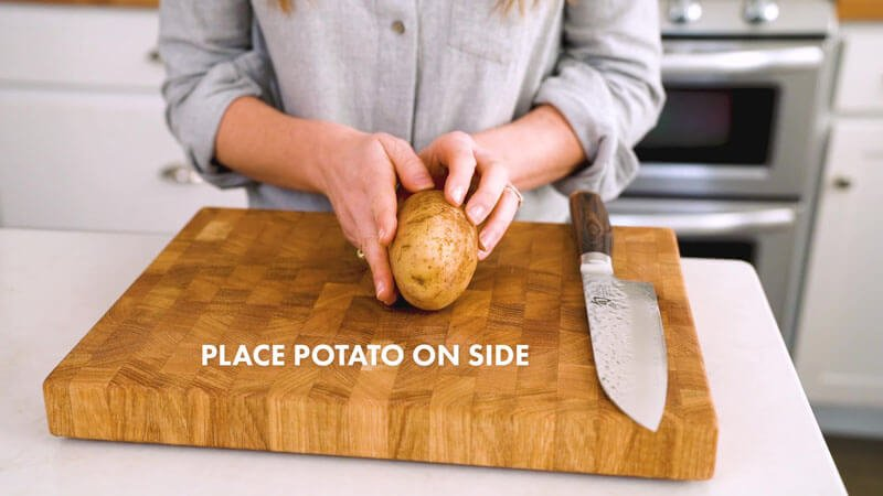 How to Cut Potato Wedges | Place the potato on its side