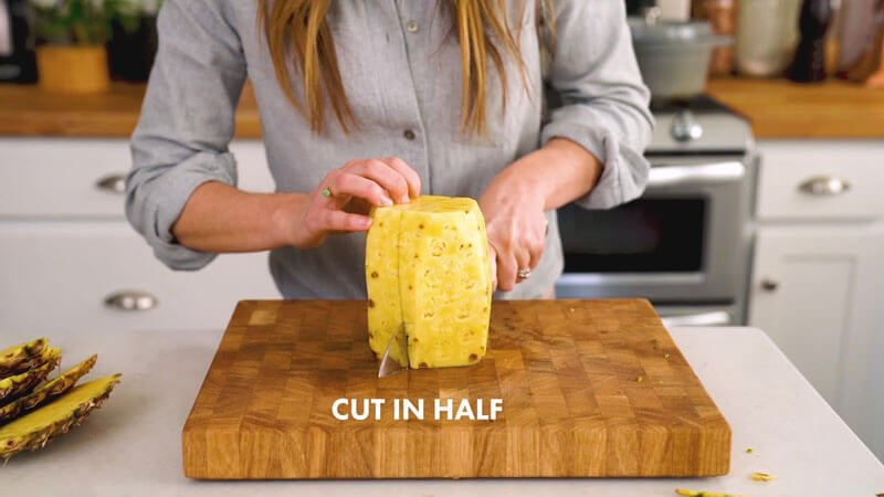 How to Cut a Pineapple | Cut in half