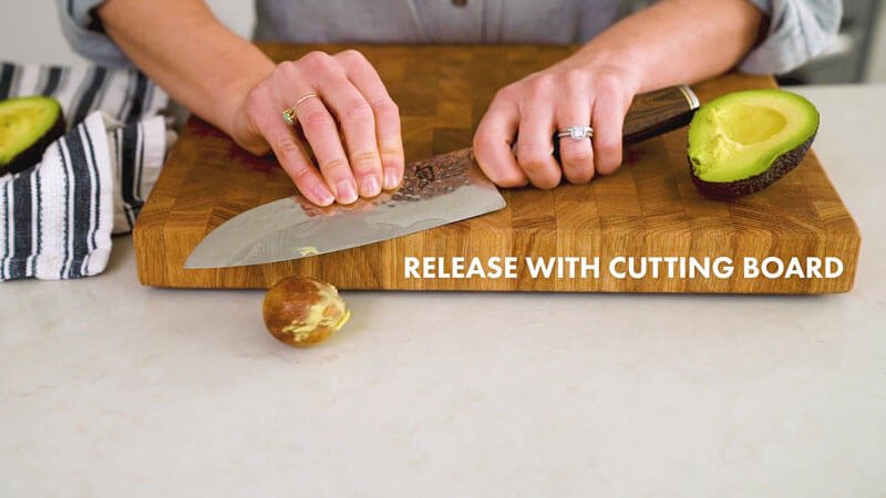How to Cut an Avocado   release the pit using the cutting board
