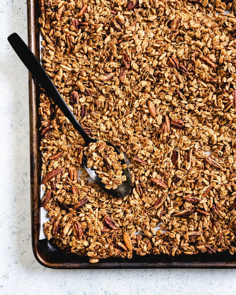 Spoon on baking sheet of healthy granola