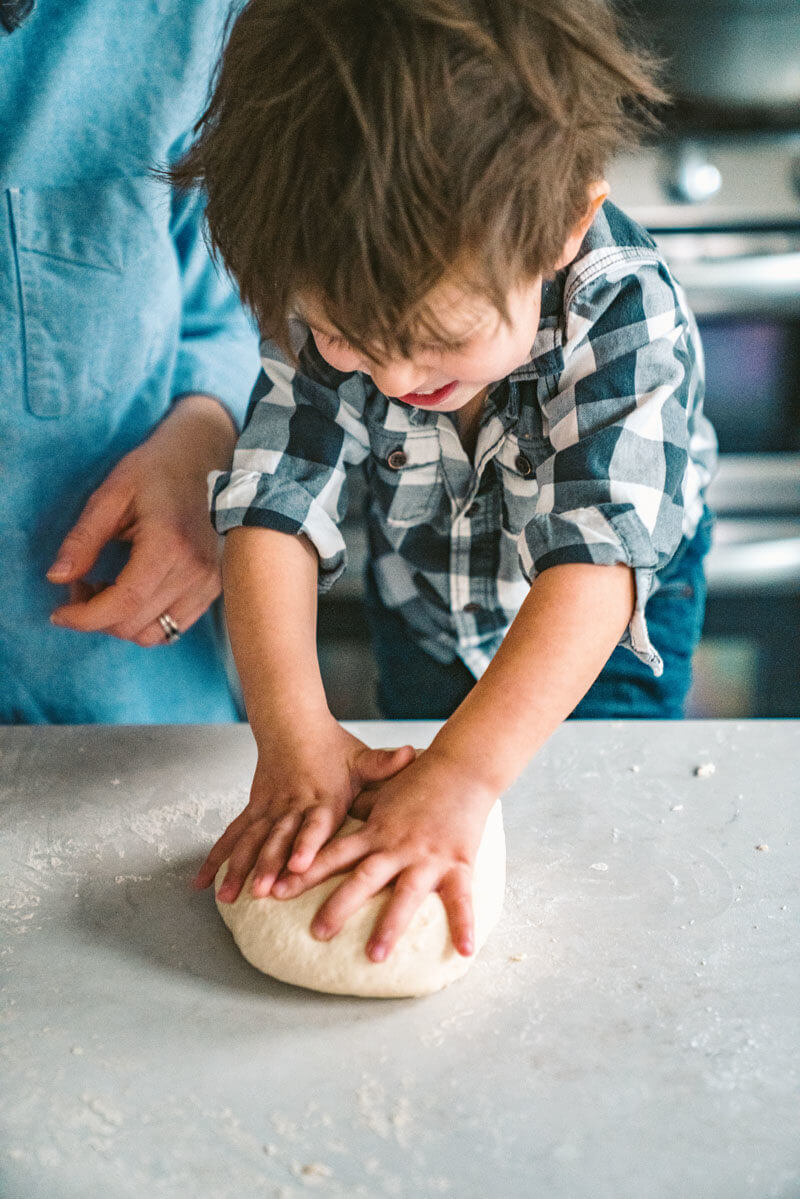 Kid kneading dough