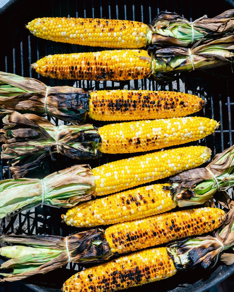 Grilled corn on grill