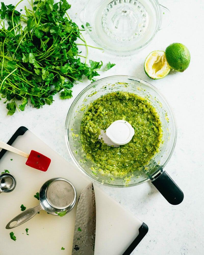 Food processor with green tomato salsa