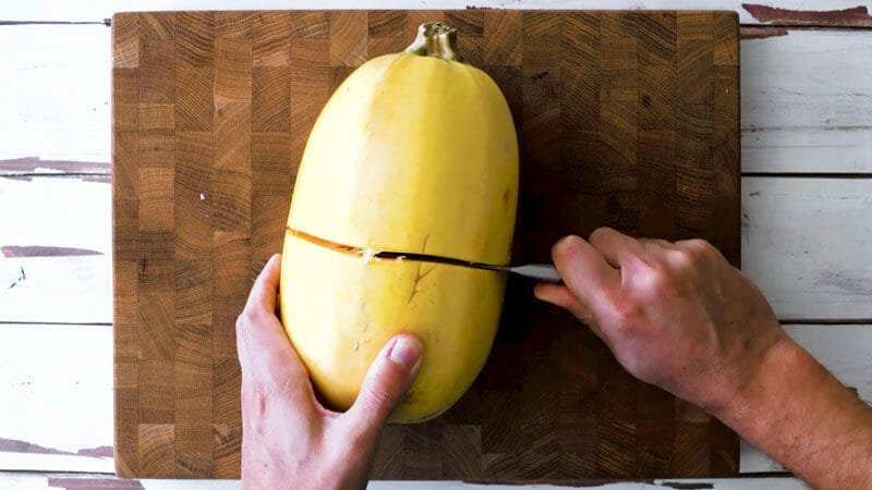 How to cut spaghetti squash: use a small sharp pairing knife to cut width-wise