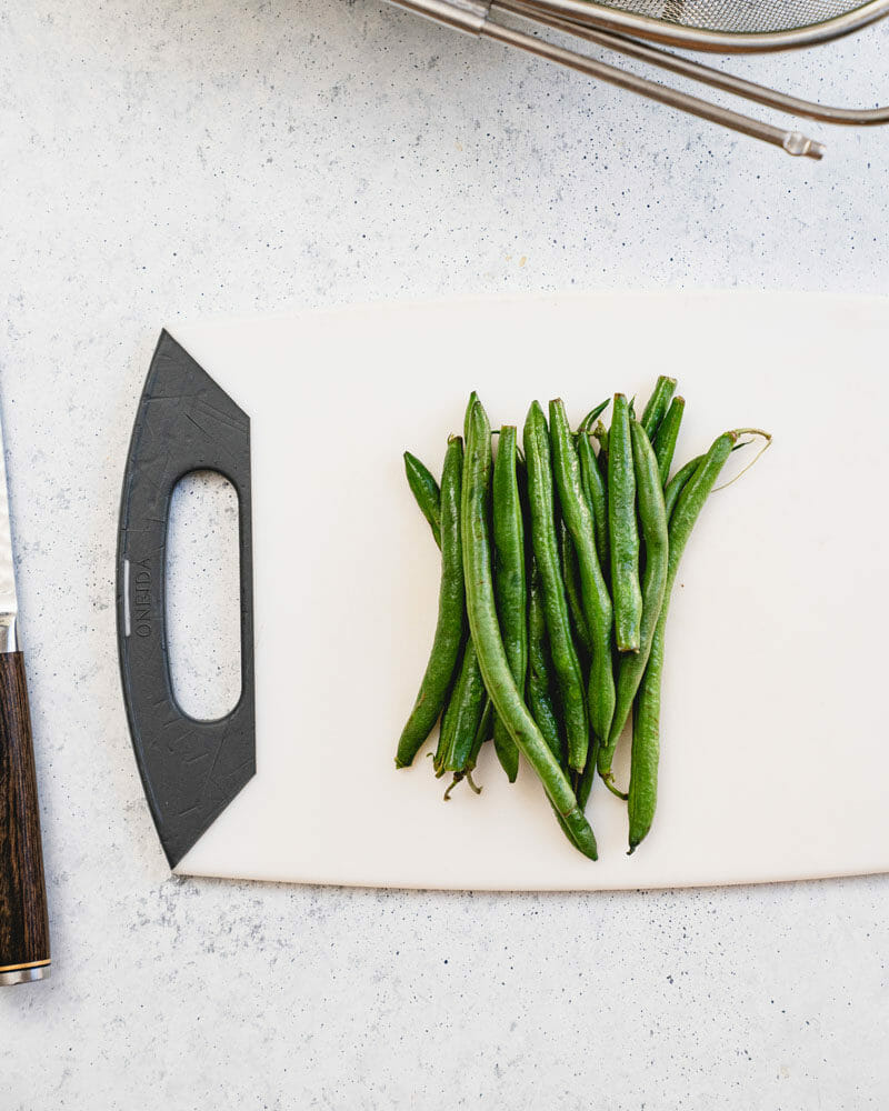 How to trim green beans: Grab a handful and place them in a pile