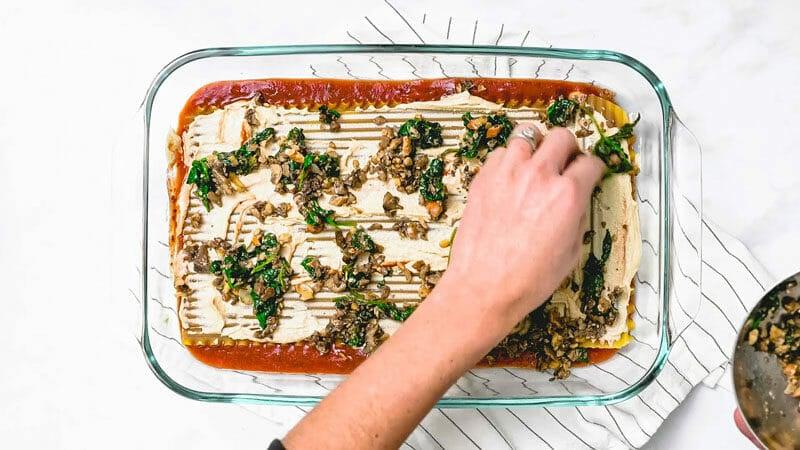 Layering dairy free lasagna