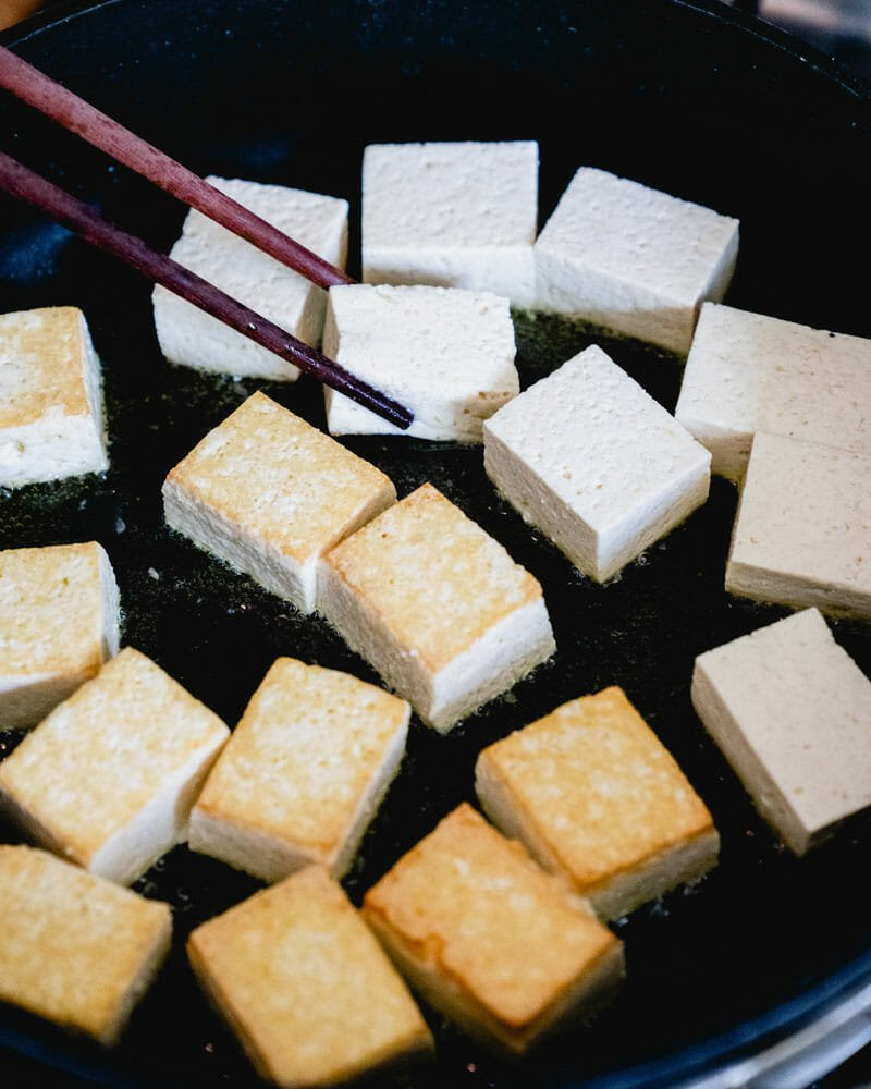 Flip the tofu with chopsticks