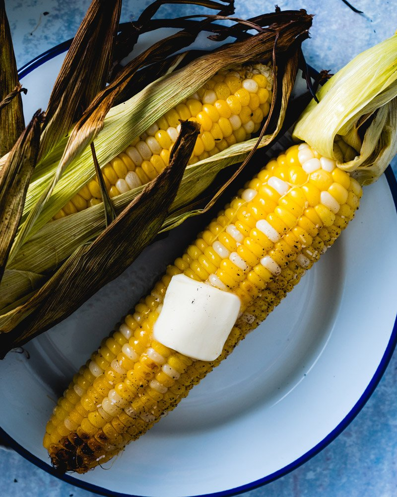 Grilled corn on the cob in husk